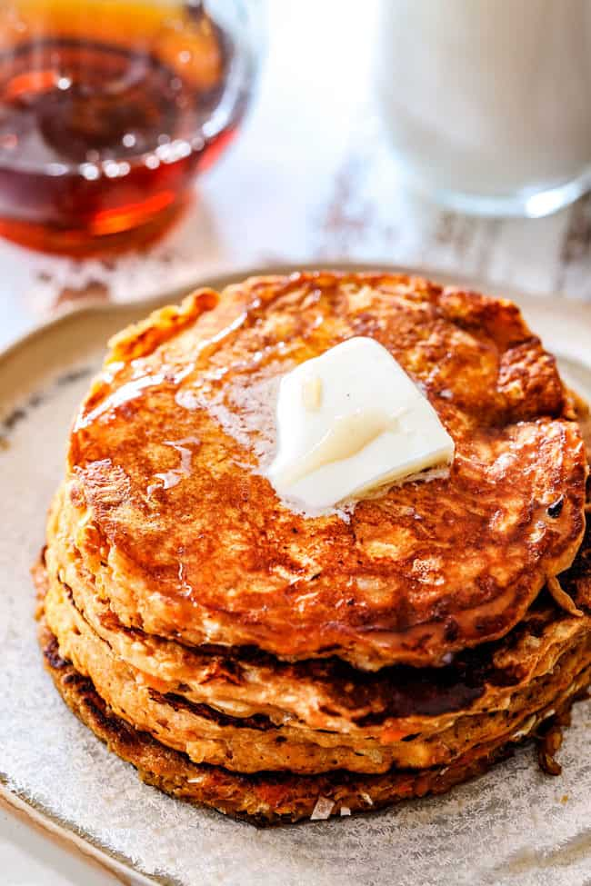 top view of a stack of leftover sweet potato pancakes with a slab of butter melting