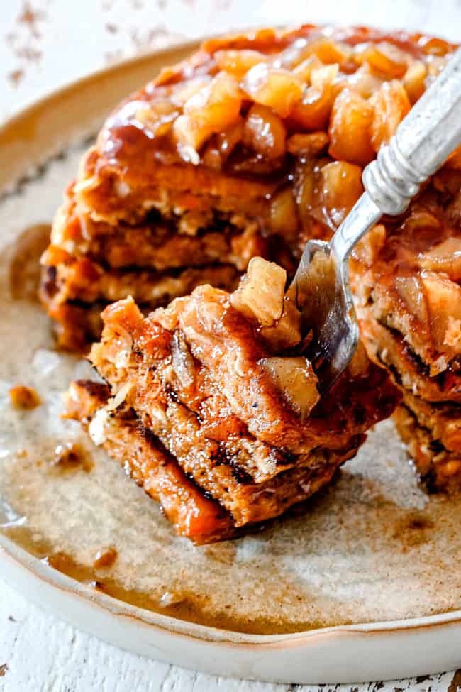 a forkful of a stack of sweet potato pancakes