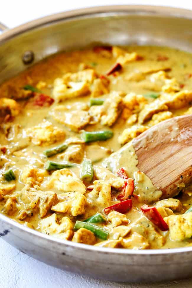 showing how to make easy coconut curry chicken by simmering until creamy