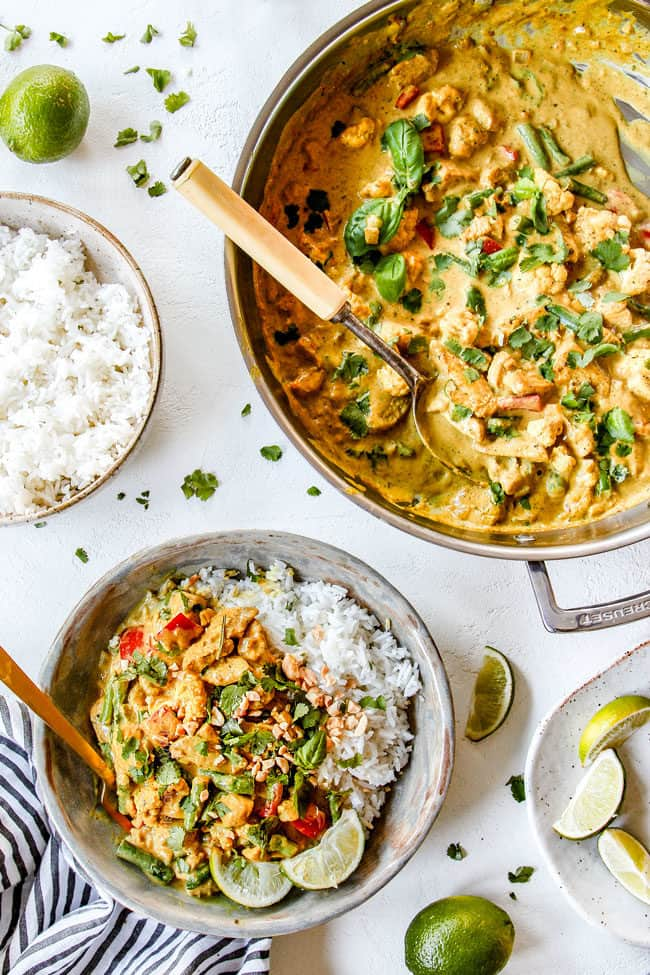 top view of easy coconut curry chicken in a stainless still skillet and in a bowl with rice