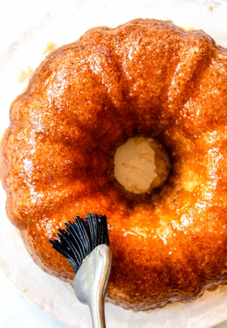 top view showing how to make Kentucky Butter Cake by brushing it with butter sauce