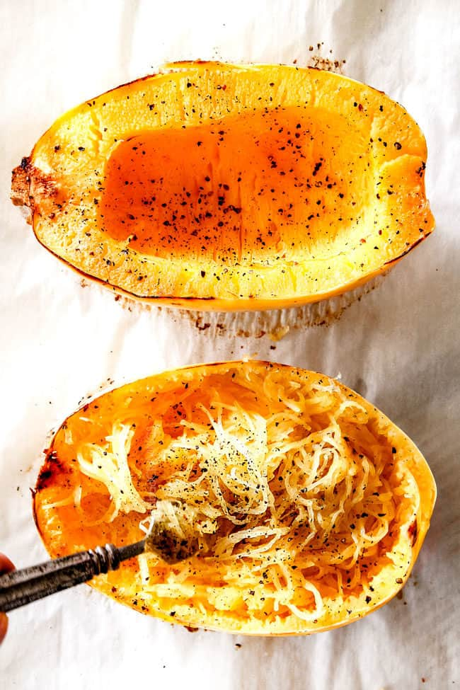 showing how to cook spaghetti squash for spaghetti by shredding cooked spaghetti squash with a fork