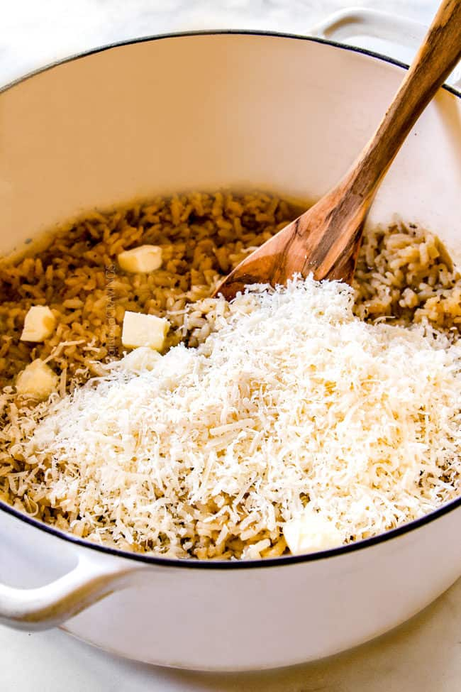 showing how to make risotto by stirring in Parmesan an butter