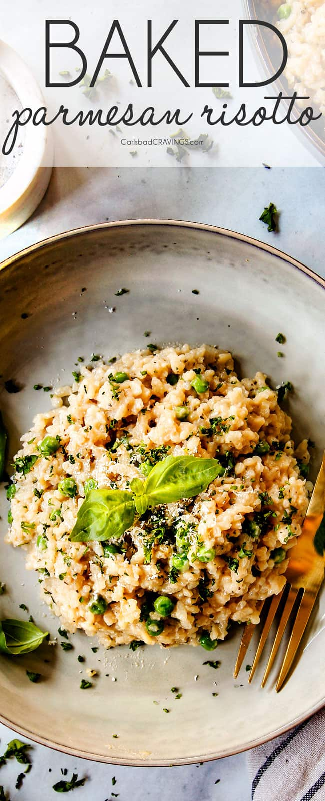 top view of Parmesan risotto recipe in a grey dish garnished with basil and parsley