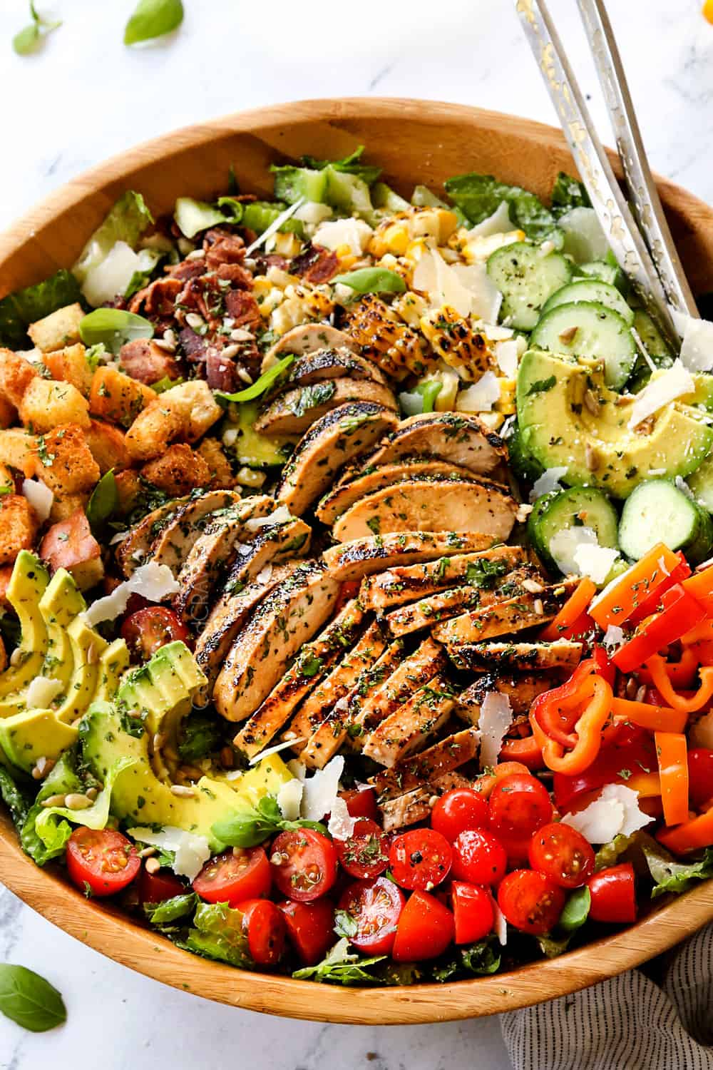 a bowl of Chicken Caesar Salad with grilled chicken, Caesar dressing and croutons