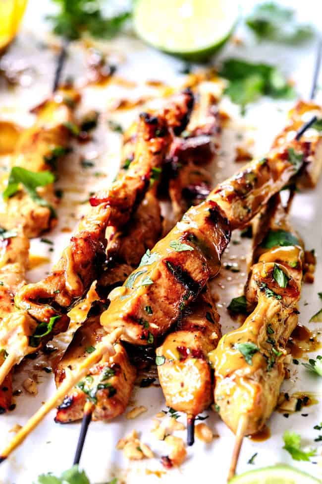 thai chicken satay with peanut sauce threaded on skewers