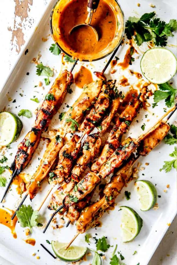 top view of grilled chicken satay with Thai peanut sauce