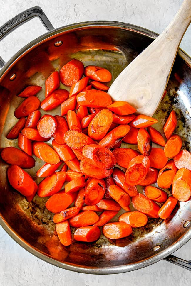 showing how to make candied carrots by cooking carrots in a skillet