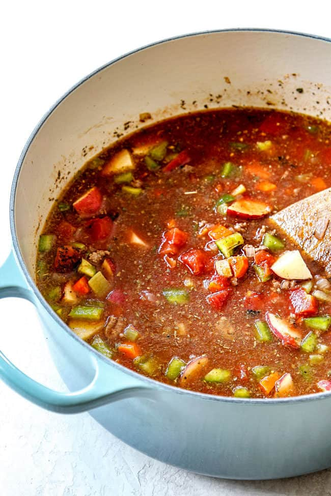 showing how to make hamburger soup by adding beef broth, tomato sauce and diced totmatoes