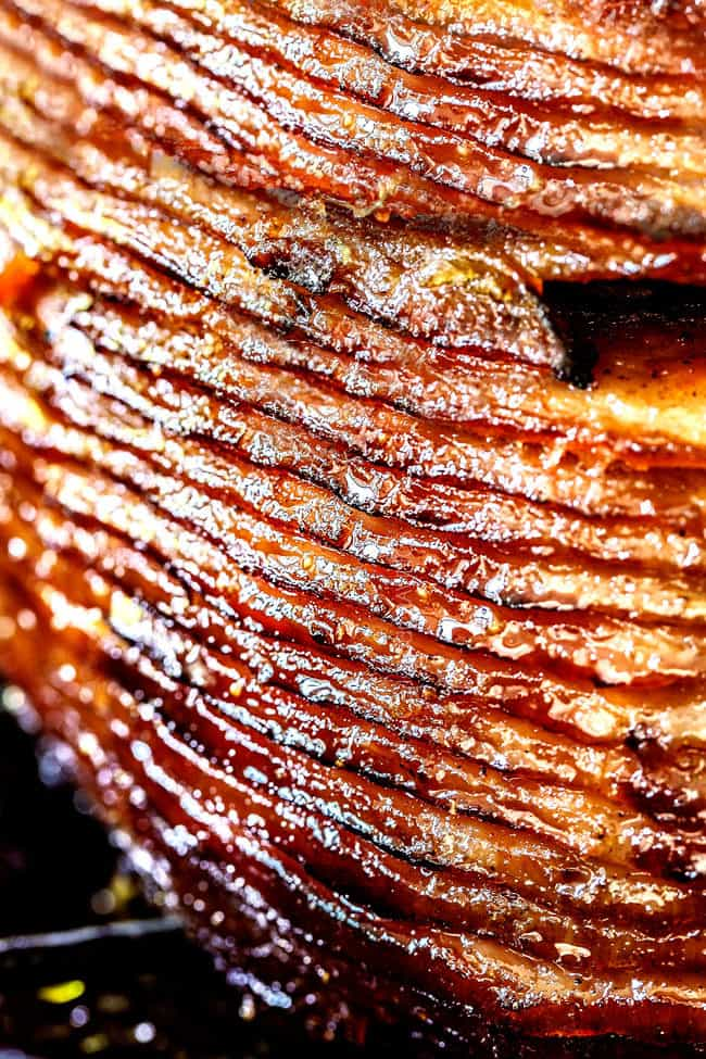 up close of honey baked ham with layers of slicces