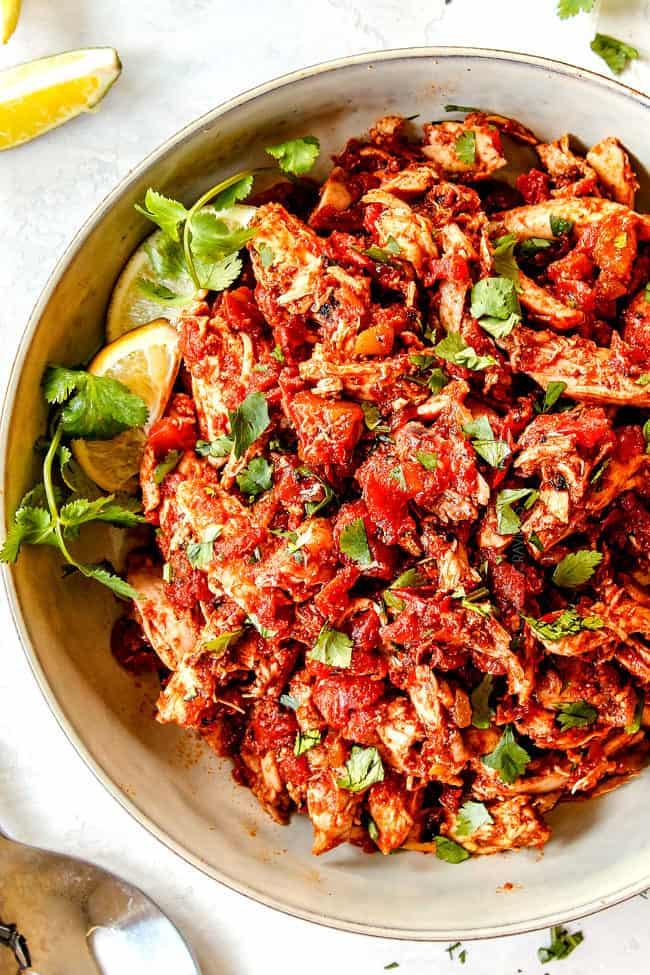 up close of Mexican Shredded Chicken in a white bowl for tacos