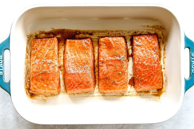 showing how to bake salmon in the oven by lining salmon fillets in a 9x13 baking dish