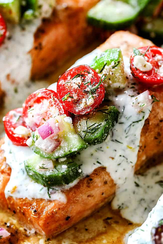 up close of oven baked salmon with dill sauce