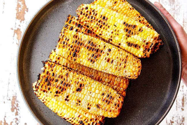 showing how to make corn salsa by grilling fresh corn on the cob