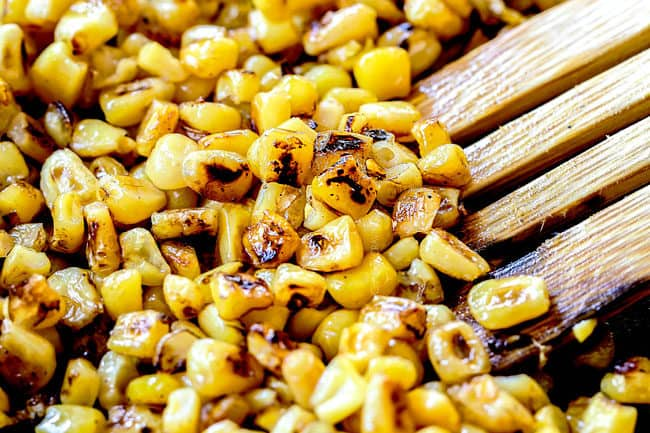 showing how to make esquites  (Mexican Corn Salad) by charring sweet corn in a cast iron skillet grilling 5 pieces of corn on the cob