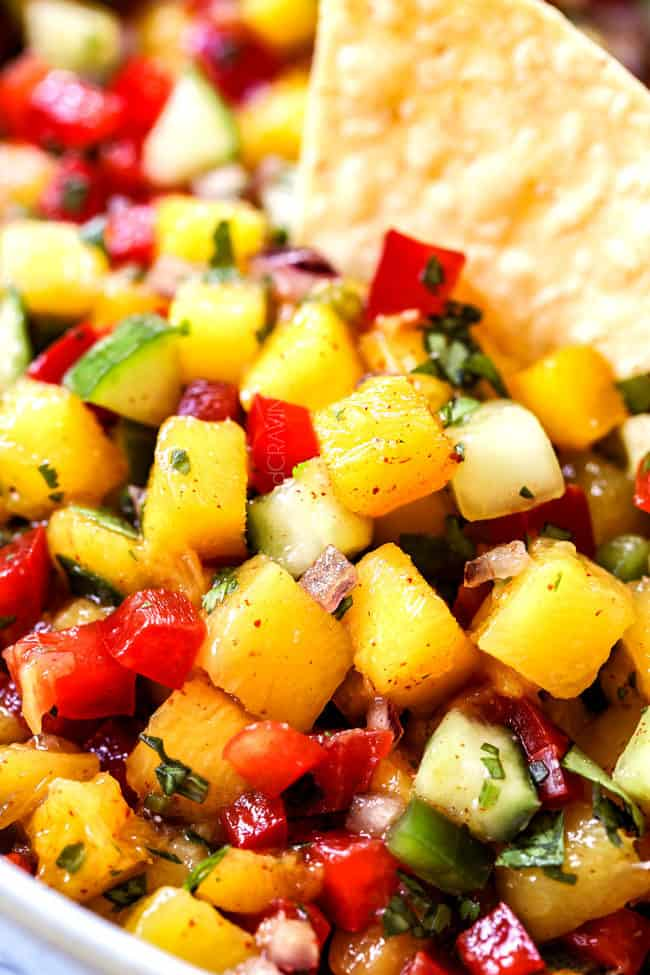 up close of a chip in easy mango salsa