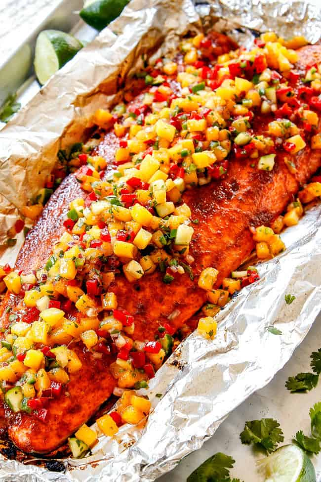 side view of salmon in foil with mango salsa