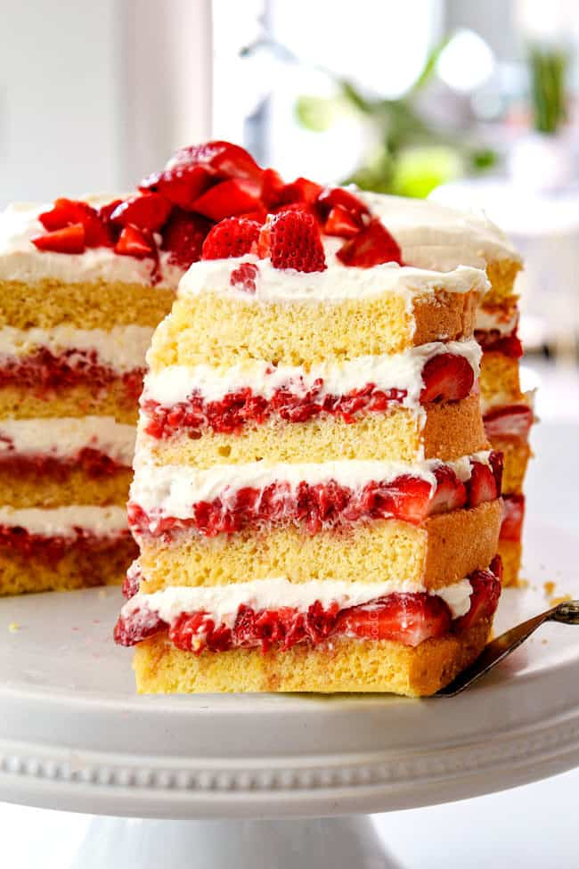 pulling out a slice of strawberry shortcake cake recipe from scratch