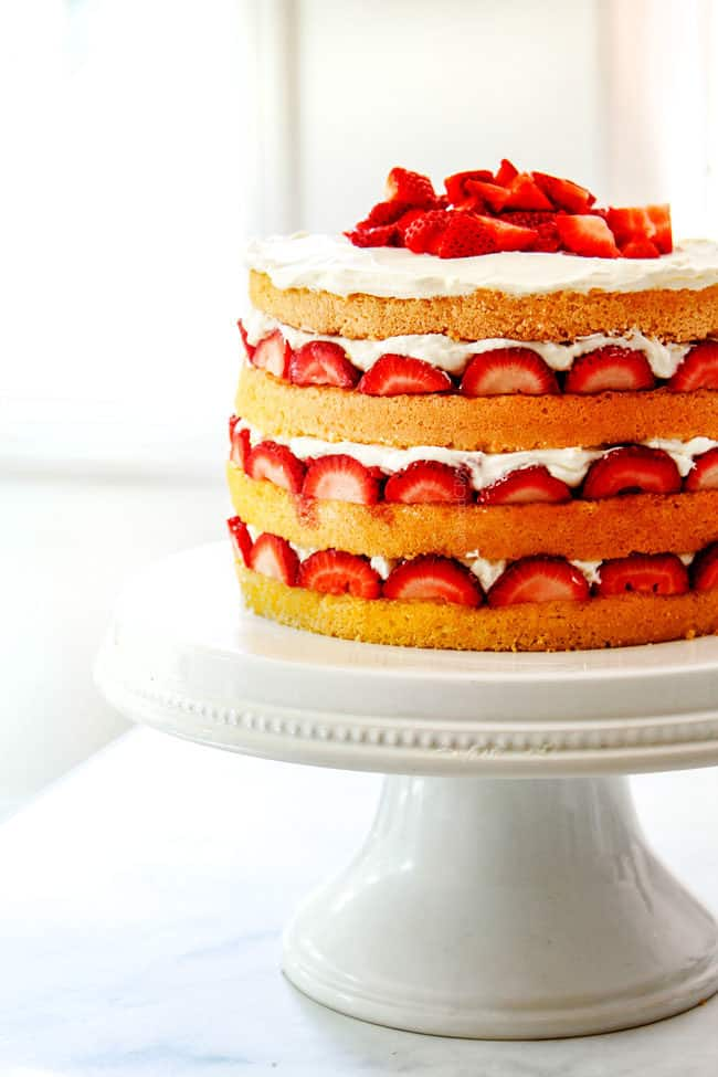 easy strawberry shortcake cake on a white cake stand