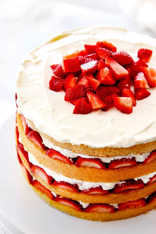 top view of strawberry shortcake cake with fresh strawberries