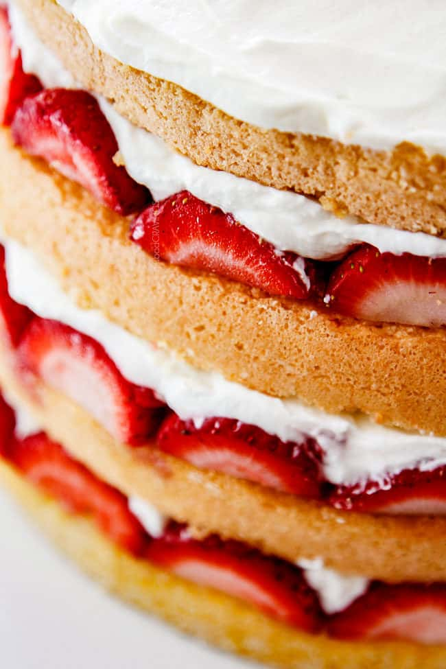 up close of layers of the best strawberry shortcake cake