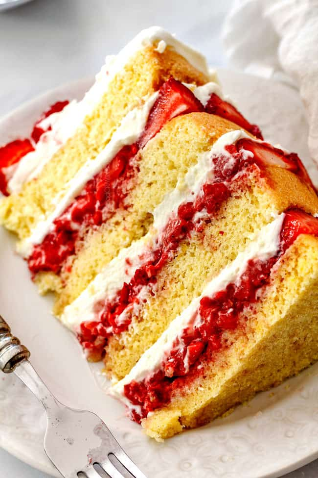 up close of a slice of the best strawberry shortcake cake recipe from scratch