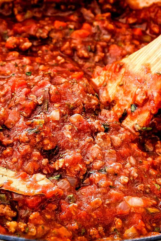 showing how to make the traditional bolognese sauce by simmering reduced