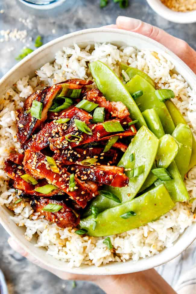 holding a bowl of Korean BBQ Chicken recipe