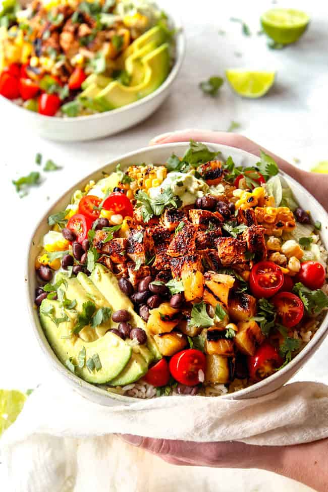 two hands holding chipotle burrito bowl