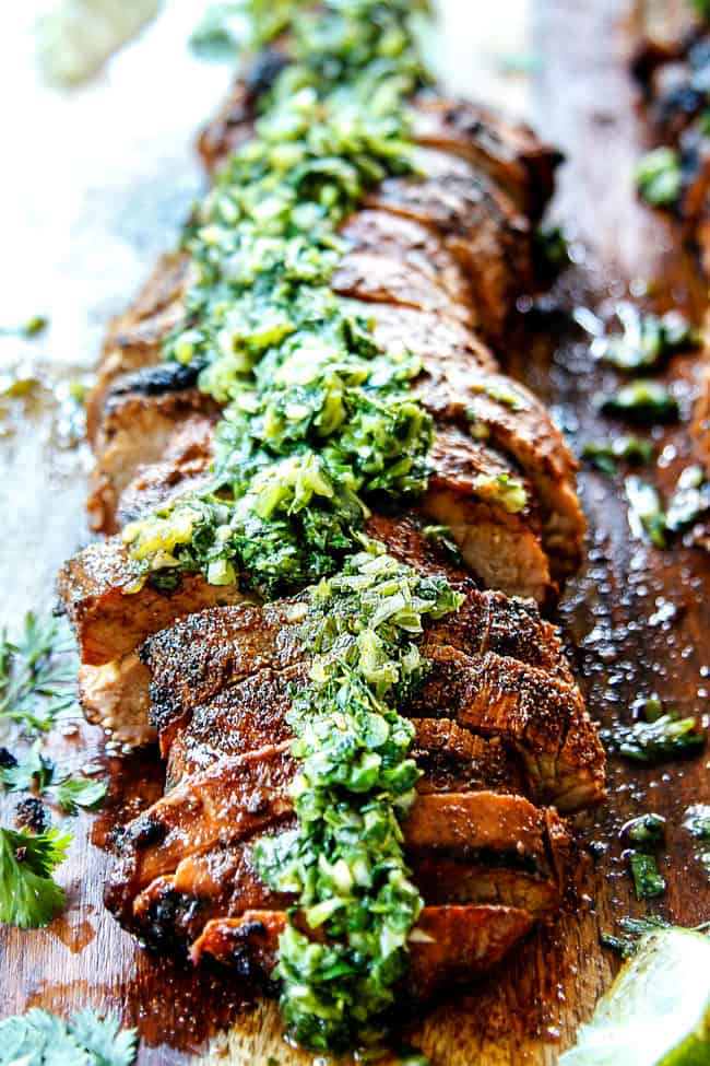 front view of grilled pork tenderloin with chimichurri