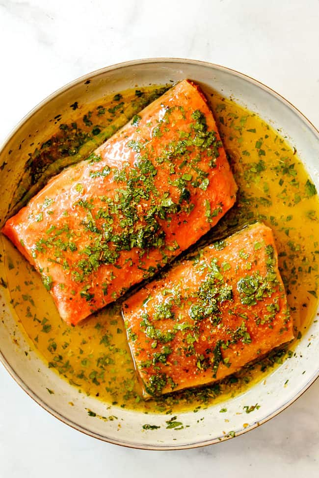 howing how to make salmon bowls by adding salmon to marinade