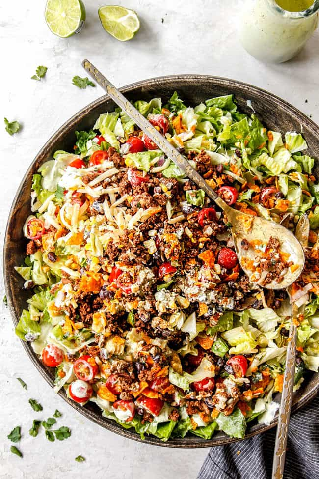 easy taco salad recipe in a large serving bowl tossed together
