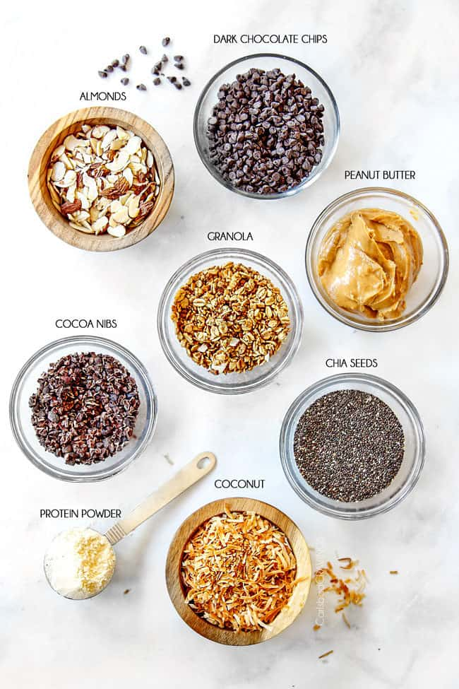 showing how to make acai bowls with toppings of granola, coconut, chia seeds, peanut butter, protein powder, cocoa nibs