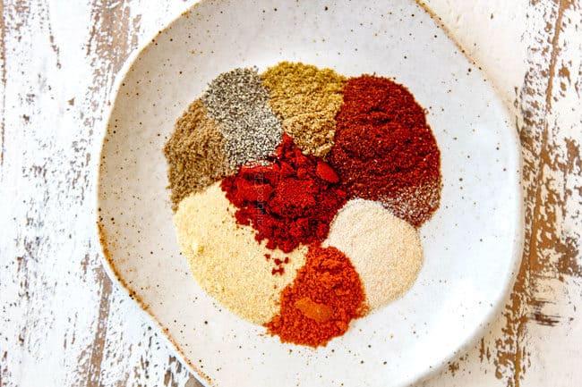 showing how to make carne asada recipe by gathering seasonings: chili powder, garlic powder, onion powder, coriander, cayenne pepper, salt