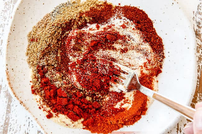 showing how to make street tacos by whisking seasonings together