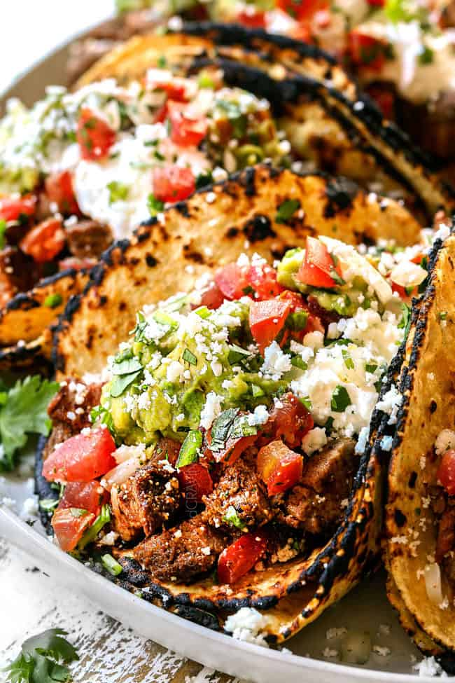 street taco recipe with carne asada lined up on a white plate