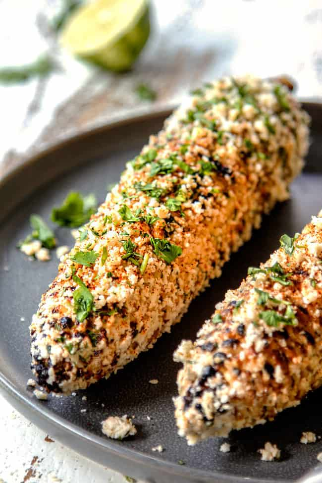 up close of elote Mexicano on a gray plate