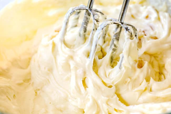 showing how to make hummingbird cake by beating cream cheese frosting