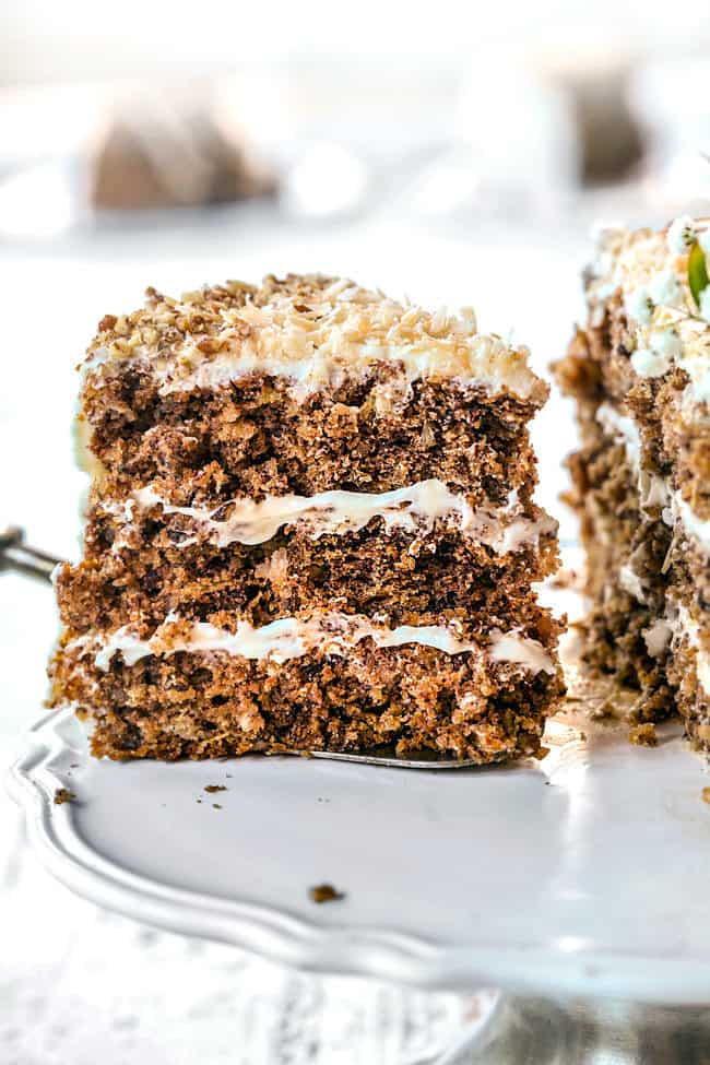 a slice of best hummingbird cake recipe  being served from cake platter