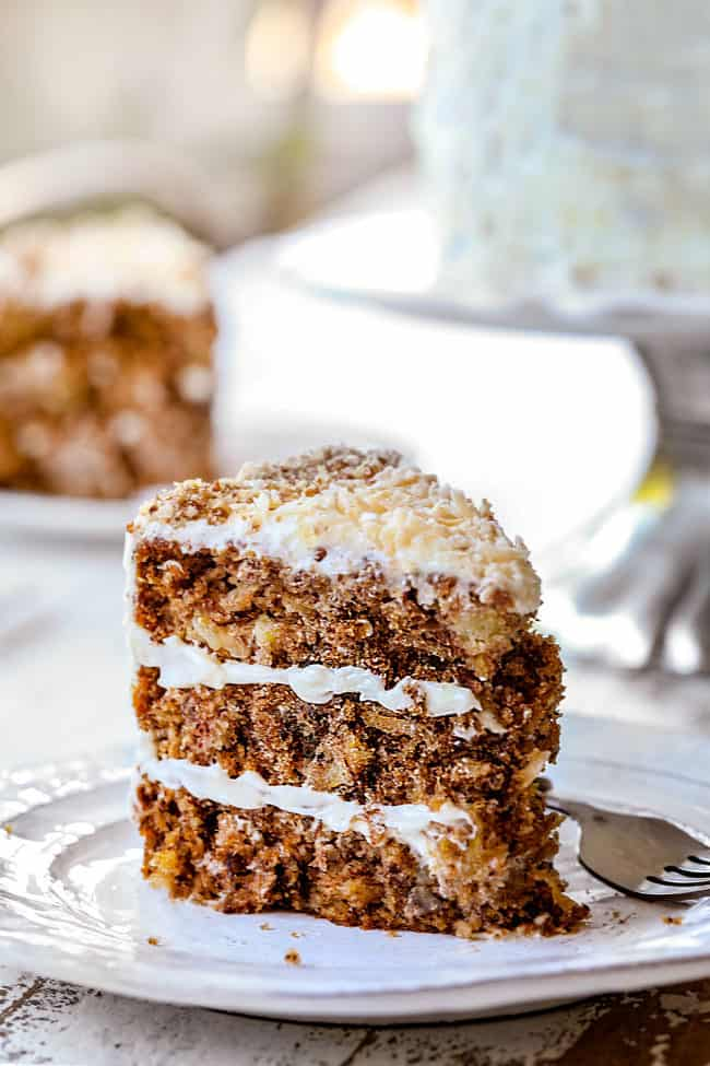old fashioned hummingbird cake on a white plate with layers