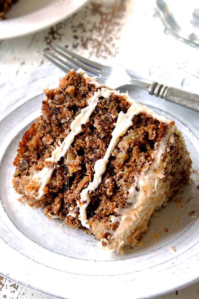 a slice of easy hummingbird cake recipe with cream cheese frosting on a white plate laying on its side
