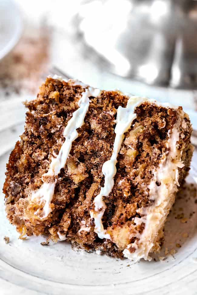 a slice of old fashioned hummingbird cake on a white plate