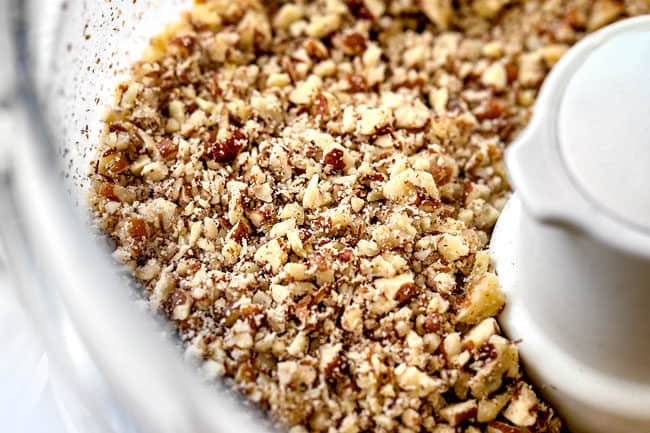 showing how to make hummingbird cake by chopping pecans