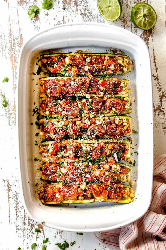 showing how to make stuffed zucchini boats recipe by filling baked zucchini with filling