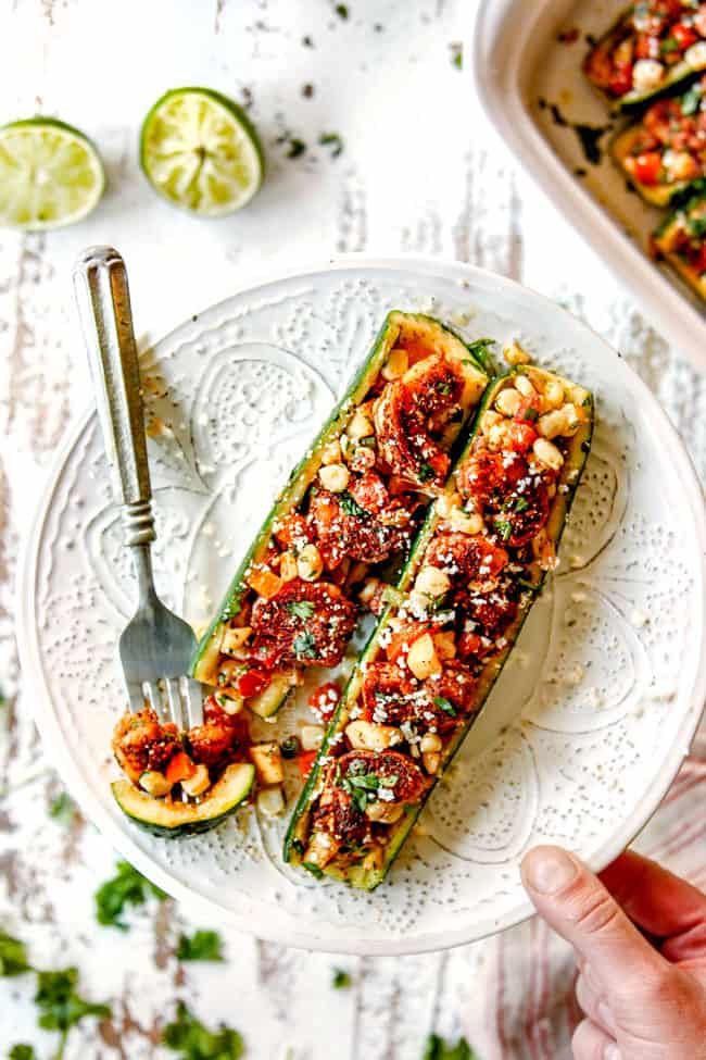 a plate showing how to serve stuffed zucchini boats