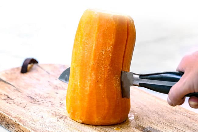 showing how to roast butternut squash by cutting squash in half