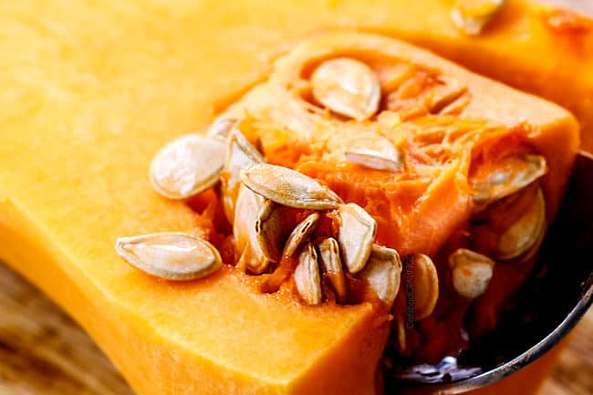 showing how to roast butternut squash by removing seeds