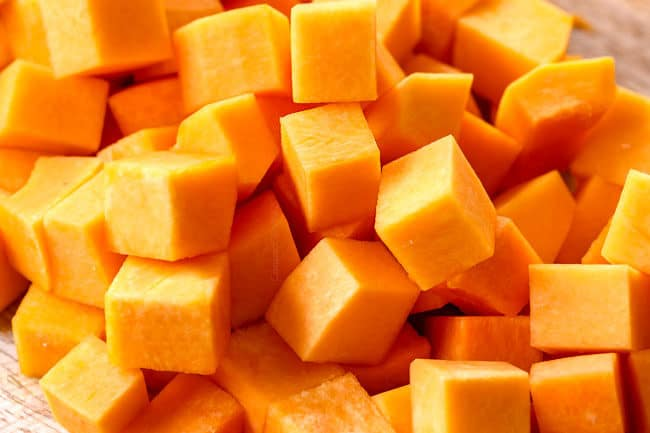 showing how to roast butternut squash by chopping into cubes