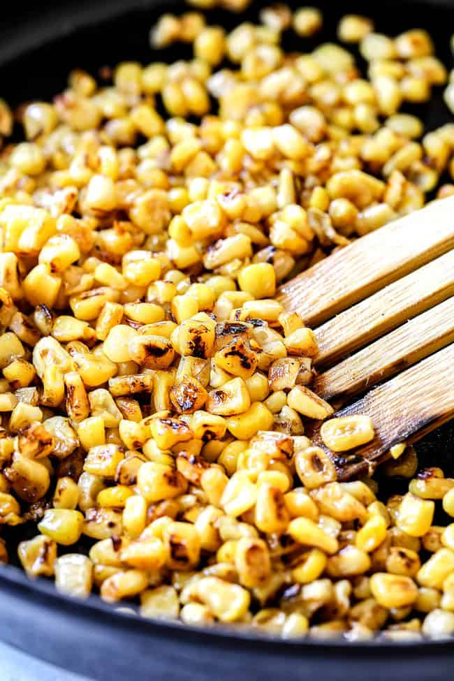 showing how to make black bean and corn salsa recipe by charring corn in a skillet