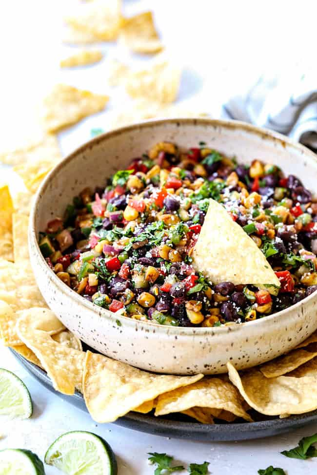 showing how to serve black bean salsa with salsa in a serving bowl